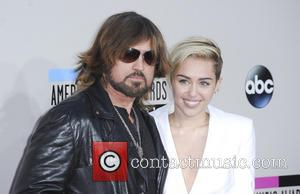 Billy Ray Cyrus and Miley Cyrus - The  2013 American Music Awards Arrivals - Los Angeles, California, United States...