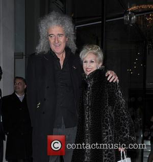 Brian May and Anita Dobson - Animal Hero Awards at the Langham Hotel - Departures - London, United Kingdom -...