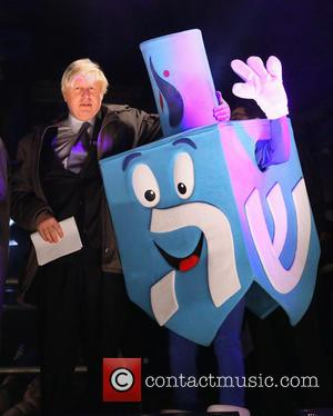 Boris Johnson and Mr Dreidel - Boris Johnson and the Chief Rabbi attend Chanukah in the Square at Trafalgar Square...