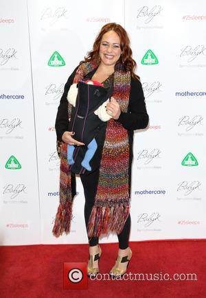 Sarah Cawood and baby - Mothercare VIP Christmas party - Arrivals - London, United Kingdom - Thursday 28th November 2013