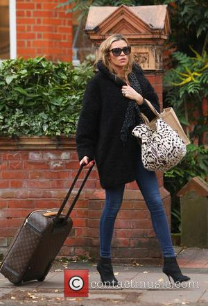 Abbey Clancy - Abbey Clancy leaves her home in North London to take her daughter, Sophia to nursery school -...