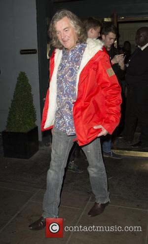 James May - James May leaving Groucho Club wearing a red jacket and a psychedelic shirt with his partner Sarah...