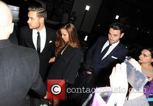Liam Payne and Guest - World Premiere of 'The Class of 92' -  Afterparty at Chakana club - London,...