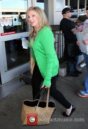 Morgan Fairchild - Actress Morgan Fairchild wearing a bright green cardigan arrives at LAX for a flight - Los Angeles,...