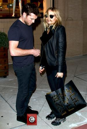 Sam Worthington - Sam Worthington and Lara Bingle leave Barney's...