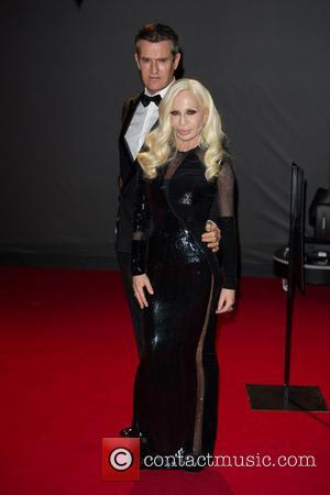 Donatella Versace and Rupert Everett - The 2013 British Fashion Awards held at the Coliseum - Arrivals - London, United...