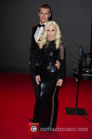 Donatella Versace and Rupert Everett