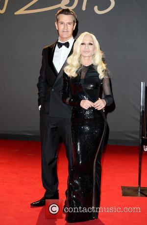 Rupert Everett and Donatella Versace