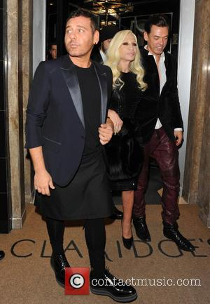 Donatella Versace and Guest