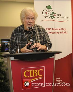Randy Bachman - Celebrities join CIBC traders and advisors on the bank's trading floor to help raise millions for kids-in-need...