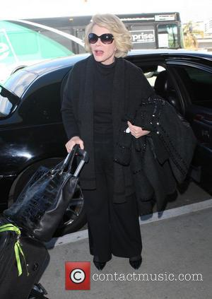 Joan Rivers - Celebrities at Los Angeles International Airport - Los Angeles, California, United States - Thursday 5th December 2013
