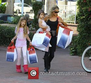 Denise Richards - Denise Richards and family laden with shopping bags after a spree at Fred Segal in Santa Monica...