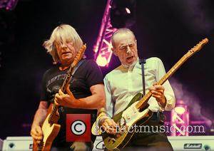 Francis Rossi, Rick Parfitt , Status Quo - Status Quo performing on the first night of their U.K. tour at...