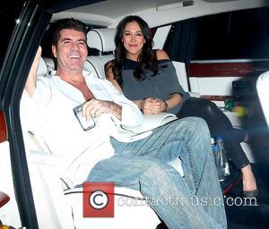 Simon Cowell and Lauren Silverman
