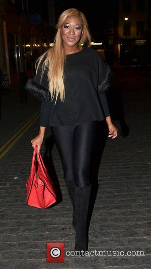 Gina Rio - Former Big Brother UK contestant Gina Rio does some Christmas shopping on London's Bond Street - London,...