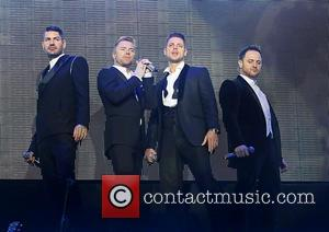 Keith Duffy, Ronan Keating, Mikey Graham and Shane Lynch - Boyzone performing on their 'BZ20 The 20th Anniversary Tour