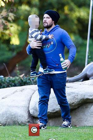 Mike Comrie and Luca Comrie - Mike Comrie takes his son Luca to play on the swings and slides at...