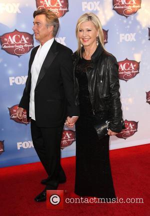 Olivia Newton-John and John Easterling - American Country Awards 2013 - Arrivals at Mandalay Bay Resort and Casino - Las...