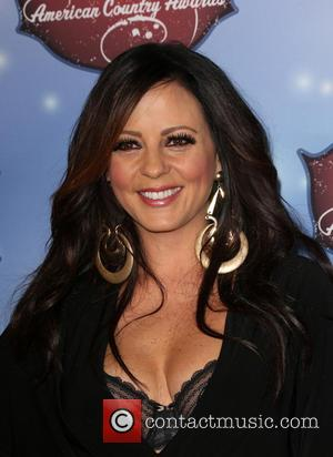 Sara Evans - American Country Awards 2013 - Arrivals at Mandalay Bay Resort and Casino - Las Vegas, California, United...
