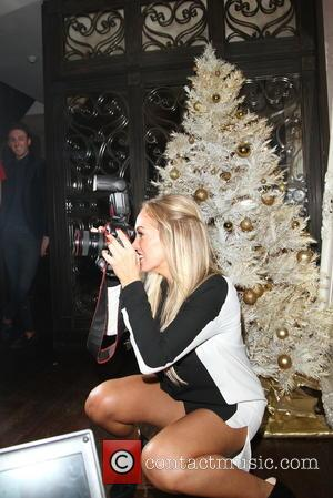 Aisleyne Horgan-Wallace - Aisleyne Horgan-Wallace takes a camera off from a paparazzi and turned tables on them by chasing them...