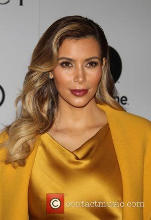 Kim Kardashian - The Hollywood Reporter's Women In Entertainment Breakfast...