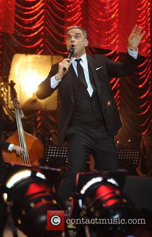 Robbie Williams - The Key 103 Jingle Ball held at Phones 4 U Arena Manchester - Performance - Manchester, United...