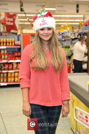 Emily Atack - Celebrities surprise Morrisons shoppers by packing their bags to help raise money for ITV's 'Text Santa' charity...