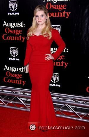 Abigail Breslin wearing Zac Posen - The New York premiere of August: Osage County held at the Ziegfeld Theatre -...