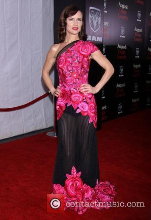 Juliette Lewis wearing Naeem Khan - The New York premiere of August: Osage County held at the Ziegfeld Theatre -...