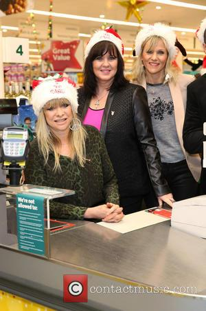 Jo Wood, Coleen Nolan and Linda Barker - Celebrities surprise Morrisons shoppers by packing their bags to help raise money...