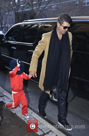 Robin Thicke and Julian - Robin Thicke and his son Julian leaving their hotel in Manhattan - New York City,...