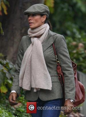 Melanie Sykes - Melanie Sykes out near her London home wearing a tweed jacket and flat cap - London, United...