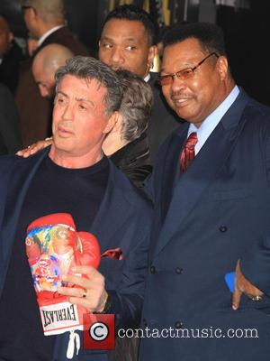 Sylvester Stallone and Larry Holmes