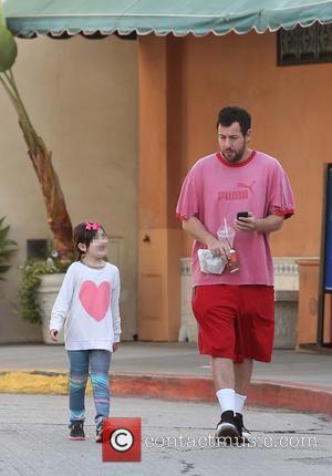 Adam Sandler and Sunny Madeline Sandler