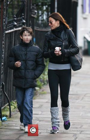 Melanie Sykes - Melanie Sykes wraps up warm for the winter weather while walking near her London home. The television...
