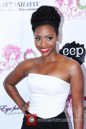 Teyonah Parris - The Curly Cartel presents 'Holiday Cheer for Charity' held at Planet Dailies at The Grove - Arrivals...