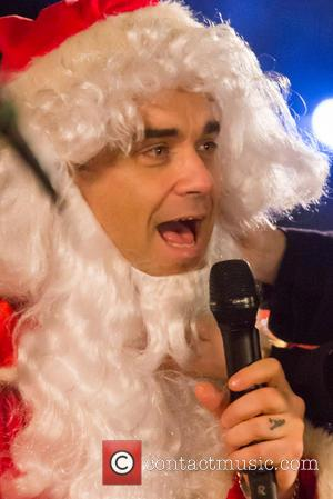 Robbie Williams - Filming for ITV's charity appeal Text Santa - London, United Kingdom - Thursday 19th December 2013