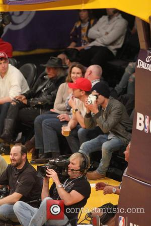 Zac Efron - Friday December 20, 2013; Celebs out at the Lakers game. The Los Angeles Lakers defeated the Minnesota...