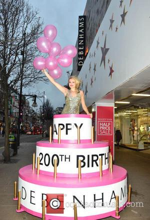 Laura Coleman - Model Laura Coleman jumps out of cake on London's Oxford Street to celebrate Debenhams 200th birthday -...