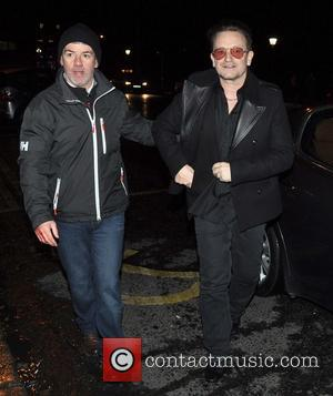 Bono - U2 frontman Bono makes his way to the Traditional Annual Christmas Eve Busking Session on Grafton Street -...