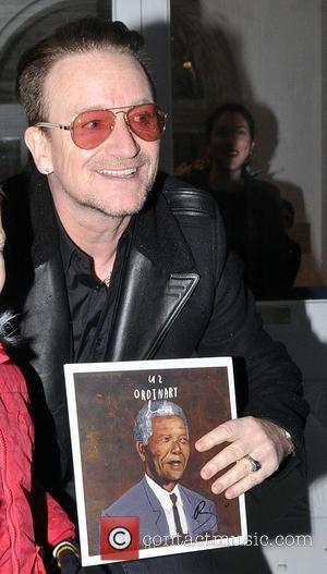 Bono - U2's Bono meets his youngest fan Sean Paul (4) from Clondakin as he was going into the Cliff...
