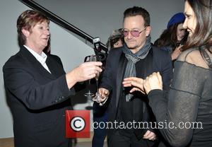 Bono Busks For Christmas