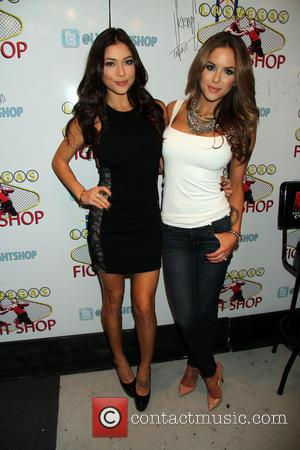 Arianny Celeste and Brittney Palmer - UFC Octagon girls ?Arianny Celeste and Brittany Palmer sign copies of their 2014 wall...