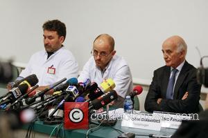 FRANCE, Grenoble : (From L) Neurosurgeon Professor Stephan Chabardes, Professor Jean-Francois Payen and Professor and Michael Schumacher's friend Gerard Saillant...