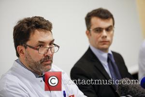 FRANCE, Grenoble : (From L) Neurosurgeon Professor Stephan Chabardes and Assistant Director Marc Penaud give a press conference about Michael...
