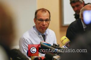 Professor Emmanuel Gay gives a press conference about Michael Schumacher's health condition on December 30, 2013 at the Centre Hospitalier...