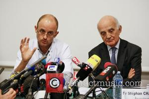 FRANCE, Grenoble : (From L) Professor Jean-Francois Payen and Professor and Michael Schumacher's friend Gerard Saillant give a press conference...