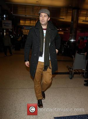 Matthew Morrison - Matthew Morrison arrives at Los Angeles International airport (LAX) wearing a rain coat and flat cap and...