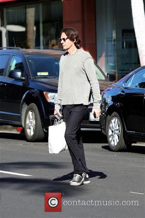 Rick Springfield - Rick Springfiend  crossing the street on Bedford Blvd - Los Angeles, California, United States - Thursday...