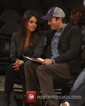 Mila Kunis - Celebs at the Lakers game.